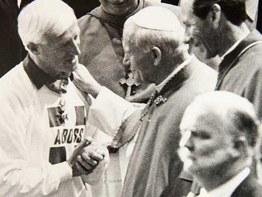 savile pope handshake.jpg